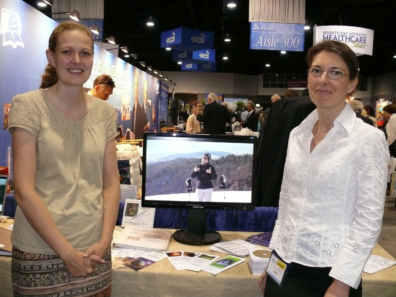 Esther Doss (left) with Valerie from France.  Esther had signed a video in the American rockies and the idea was copied by Valerie and her friends from France.  The product you can see on the screen as signed in the European alps.