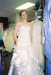 This is NOT her wedding dress!  We kept making fun of this floofy dress hanging on the rack, and the sales lady told us to quit knocking it and try it on.  Although it does certainly look better on, definitely still room for teasing...