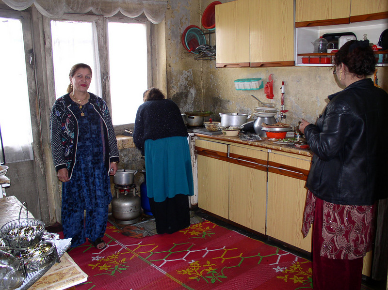 This is the mother (grandmother) in the kitchen. Generally the younger women do all the cooking.