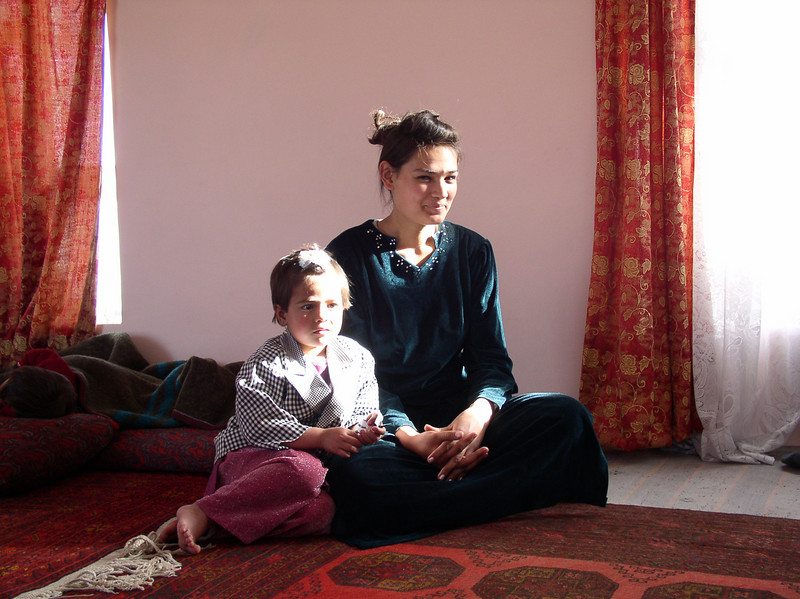 This is Afghanistan's tragedy. For all of you who are parents, the older girl is 18, the younger 3. They are related. The oldest has never been educated, she is orphaned and stays at home caring for the younger children and household. She is absolutely beautiful and has a Madonna quality the way she cares for the children. How can you help? Support the concept of educating these children. She is a victim of the Taliban's medieval experiment in religious governance. She is lucky because she is being cared for by Dr. Azfar (step-sister) . Dr. Azfar said that before the war, there was not one member of his family (for generations) that was illiterate.
