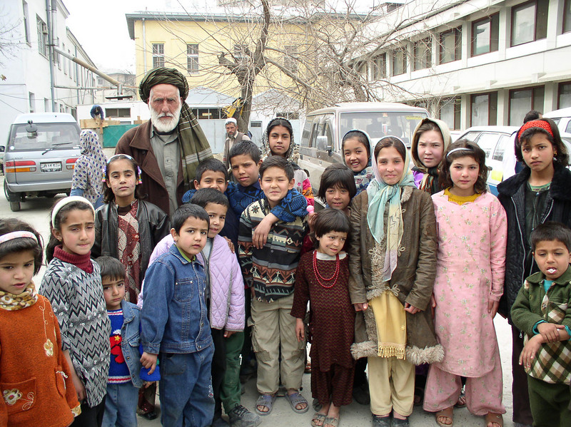 The turban man and courtyard kids.