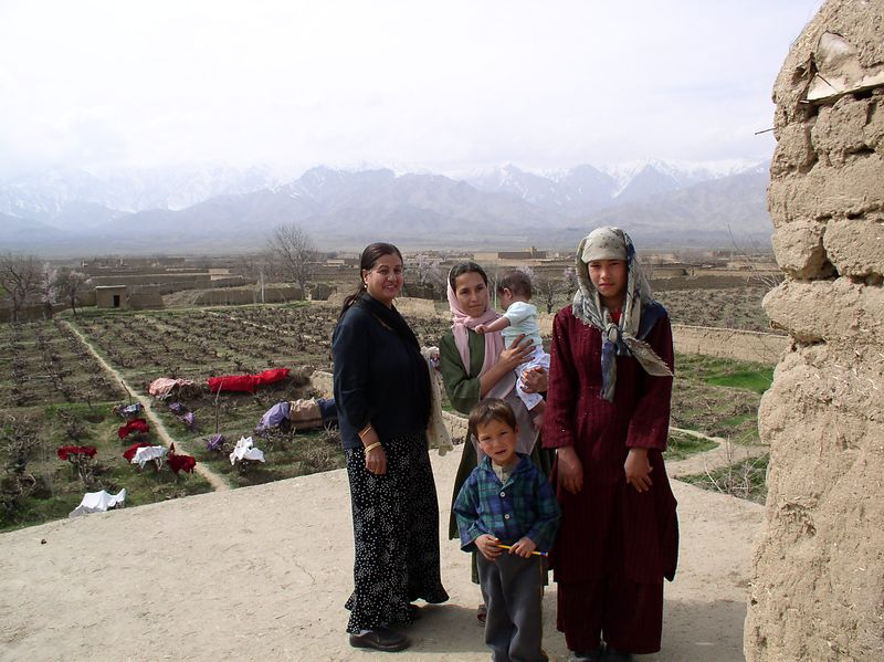 Soraya, Anisa, the gardner's grandchildren (3 out of 50) and a rooftop view of the beautiful orchards. Incredible place on earth-50 miles north of Kabul.
