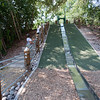 A couple of neighborhood kids join Sue on the slide