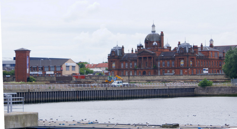 Closer view of the new southern extremity of the canting basin, Govan Town Hall and the remaining accumulator tower that was added to supplement the output of the Four Winds power station.