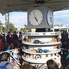 The animated McVitie's clock with crowd gathering to watch the 5 o clock show.