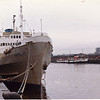 "In this 1978 view the Greek Epirotiki Lines passenger ship Odysseus is seen laid up at Mavisbank Quay in Glasgow with the preserved paddle steamer Waverley and the small motor vessel Queen of Scots across the river at Stobcross Quay (the then base of Waverley Steam). Orininally the Odysseus had  been the Irish Sea mailboat Leinster before going to Greece as a small cruise ship. In the early 1970s she returned to the UK as a workers accommodation vessel at the oil platform construction yard at Loch Kishorn in Wester Ross. She was laid up at Mavisbank Quay for a time after that work finished.<br /> <br /> In 1988 Mavisbank Quay was utilised as part of the Glasgow Garden festival. During the 1990s the eastern part of the quay was redeveloped for residential purposes and is now known as Mavisbank Gardens<br /> <br /> In 2006 the western part of Mavisbank Quay became the home of the new studios of STV (Scottish Television):<br /> <br />  <a href=""http://pudzeoch.smugmug.com/gallery/5191499_5SFuX#316958416_mLaDi-XL-LB"">http://pudzeoch.smugmug.com/gallery/5191499_5SFuX#316958416_mLaDi-XL-LB</a>"