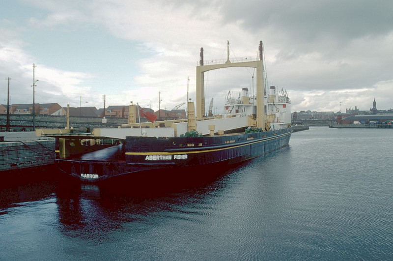 The last commercial cargoes shipped from the Prince's Dock were taken by the special heavy lift ships Aberthaw Fisher and Kingsnorth Fisher - the former seen at Berth No 29