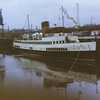 Another view of the Clyde turbine steamer Queen Mary II berthed at the south wall of the Princes Dock canting basin in May 1973 <br /> <br /> The large crane on the quay just ahead of the steamer was the third generation of cargo handling equipment provided at that berth since the opening of the Princes Dock in 1893. It succeded the coal hoist noted earlier