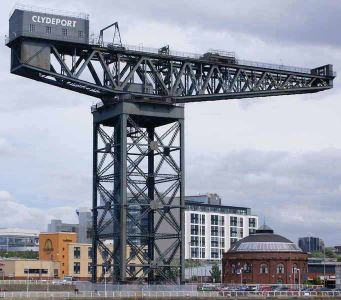 "The electrically-powered Stobcross Crane, or Crane No 7 as it was named by the Clyde Navigation Trust when it was built in 1932, is no longer in use as a dock facility. See the cranes designation board at the following link;<br /> <br /> <a href=""http://discuss.glasgowguide.co.uk/blog/gg/index.php?showentry=45"">http://discuss.glasgowguide.co.uk/blog/gg/index.php?showentry=45</a><br /> <br /> The crane was built by Cowans Sheldon to replace the smaller steam-powered Finnieston Crane which was located about 500 feet upriver (where the City Inn now stands) as there was a plan in the 1920s to build a high level bridge across the river where the latter crane was located. In fact the new bridge did not appear until 70 years later (the Clyde Arc) and, when it did, it was not a high level bridge. However, Glasgow Corporation met 85% of the £65,000 cost of the new  Stobcross crane. The picture at the following link (Glasgow Mitchell Library) shows the Stobcross Crane under construction and the Finnieston Crane further along the quay towards the right side of the picture. The Finnieston crane had been built in 1893 and had a maximum lift capacity of 130 tons. Although the new Stobcross crane had only 45 tons greater maximum lifting capability, it could slew such weights to a much greater distance off the quay and it was not uncommon to see two ships berthed side-by-side beneath the new crane.<br /> <br /> <a href=""http://www.mitchelllibrary.org/virtualmitchell/image.php?i=14208&r=2&t=4&x=1"">http://www.mitchelllibrary.org/virtualmitchell/image.php?i=14208&r=2&t=4&x=1</a><br /> <br /> <br />  A knock on effect of the new crane was the need to relocate the terminals for the Finnieston to Mavisbank vehicular and passenger ferry, which can also be seen on the previous link picture. They were moved approximately a quarter of a mile upsteam after which the ferry crossed from Lancefield Quay at Elliot Street to <br /> <br /> For a while both the Stobcross Crane and the Finnieston crane were used to load heavy machinery onto vessels alongside the adjacent quay but eventually, as requirements reduced, the old Finnieston crane was removed. The Stobcross crane continued to lift many export steam locomotives form Glasgow's four huge locomotive building workshops at Springburn and Queens Park. The Springburn works alone produced in excess of 24,000 locomotives. The  crane also lifted marine engines, built at the nearby works of David Rowan & Company (in Elliot Street off Lancefield Quay), into new ships and also heavy engineering products such as boiler parts, fans, pumps and gas turbines from local builders such as James Howden (Scotland Street), John Brown Engineering (Clydebank), G & J Weir (Cathcart) and Babcock & Wilcox (Renfrew) for export."