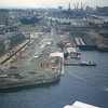 "Views from the Clydesdale Bank Tower looking west - The three deserted Govan Graving Docks after the dockside Arrol cranes had been removed without permission.<br /> <br /> Dock No 1: Opened 1875<br /> Length 551 feet Width of Entrance 72 feet Depth on Sill 20 feet 10 ins (Spring Tide)<br /> <br /> <br /> Dock No 2: Opened 1886<br /> Length 575 feet Width of Entrance 67 feet Depth on Sill 22 feet 10 ins (Spring Tide)<br /> <br /> <br /> Dock No 3: Opened 1897<br /> Length 880 feet Width of Entrance 83 feet Depth on Sill 26 feet 6 ins (Spring Tide)<br /> <br /> The first link shows No 3 Dock with three MacBrayne paddle steamers undergoing annual refurbishment - PS Columba is the nearest vessel with PS Grenadier and PS Gael beyond.<br /> <br />  <a href=""http://www.theglasgowstory.com/imageview.php?inum=TGSA01509&PHPSESSID=aa5730b8cd8722a3ea61f3a026562a85"">http://www.theglasgowstory.com/imageview.php?inum=TGSA01509&PHPSESSID=aa5730b8cd8722a3ea61f3a026562a85</a><br /> <br /> The second link is a view across the No 1 and No 2 Docks in the lake 19th C. Clan Alpine is the vessel in No 1 Dock. In the background a Clyde paddle steamer is under repair on John Shearer's Kelvinhaugh Slipdock which was an older shiprepair yard. The Kelvinhaugh Slipdock and Stobcross Slipdock run by Barclay Curle were superceded by the three drydocks at Govan, the Kelvin drydock and the first of three drydocks at Elderslie.<br /> <br />  <a href=""http://briandosborne.files.wordpress.com/2008/05/11-shipping-on-clyde.jpg"">http://briandosborne.files.wordpress.com/2008/05/11-shipping-on-clyde.jpg</a><br /> Go to following link for an excellent set of engineering drawings of the docks:<br /> <br />  <a href=""http://www.hiddenglasgow.com/GovanGravingDocks/engineering/index2.htm"">http://www.hiddenglasgow.com/GovanGravingDocks/engineering/index2.htm</a><br /> <br /> More information on these Govan Graving Docks at<br /> <br />  <a href=""http://www.hiddenglasgow.com/GovanGravingDocks/index.htm"">http://www.hiddenglasgow.com/GovanGravingDocks/index.htm</a><br /> <br /> The white houses beyond the docks occupy the site of the former Harland & Wolff shipyard which was previously three yards. One of the yards was occupied by Robert Napier & Son. Adjacent to that yard was the London & Glasgow Engineering & Iron Shipbuilding Co.<br /> The cranes in the background are in the shipyard that commenced in the 1860s as Randolph, Elder & Co becoming successively John Elder & Co, Fairfield Shipbuilding & Engineering Co, Fairfield (Glasgow) Ltd, Upper Clyde Shipbuilders (Govan Division), Govan Shipbuilders Ltd, Kvaerner Govan Ltd, BAE Systems Surface Fleet Solutions Ltd and is now part of BVT Surface Fleet Ltd."