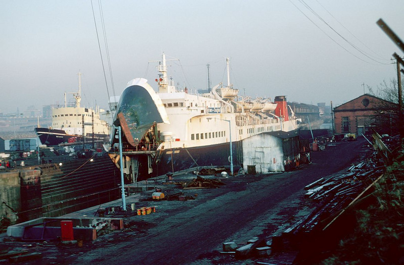 """In this view the Manx Line roll on, roll off ferry Manx Viking was being overhauled in Govan No 3 drydock while the fisheries research vessel Scotia, built by Ferguson Brothers at Port Glasgow was lying at Berth No 85. <br /> <br />  <a href=""""http://www.clydesite.co.uk/clydebuilt/viewship.asp?id=412"""">http://www.clydesite.co.uk/clydebuilt/viewship.asp?id=412</a><br /> <br /> <br /> The red brick building at the extreme right of the picture was the power station that drove the dock pumps and other machinery. See details at:<br /> <br />  <a href=""""http://www.hiddenglasgow.com/GovanGravingDocks/engineering/pages/Dock2_CrossSection_ShowingE_gif.htm"""">http://www.hiddenglasgow.com/GovanGravingDocks/engineering/pages/Dock2_CrossSection_ShowingE_gif.htm</a>"""