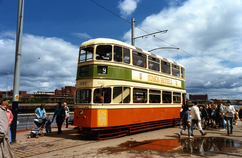 "Arguably, the most nostalgic feature of the festival was the temporary return of tramcars to the city after an absence of quarter of a century. Car No 1297 returned to the city of its creation from the National Tramways Museum at Crich. This vehicle is one of six ex Glasgow 'caurs' preserved at Crich, the others being cars No 22, 812, 1100 (in storage, not displayed), 1115 and 1282. In addition Liverpool tramcar 869, which was sold to Glasgow Corporation Transport in 1954, is at Crich but has been restored to her original Liverpool livery.<br /> <br /> No 1297 took part in the final procession of tramcars through Glasgow streets in 1962, an event that drew large crowds. Each of the trams at the Festival was sponsored by a company, No 1297 being sponsored by Stakis Hotels. View this picture at x3 for detail of the great standard of preservation of these vehicles.<br /> <br /> See the trams at Crich at the following website:<br /> <br />  <a href=""http://www.tramway.co.uk/smx/cms/tramfleet2/"">http://www.tramway.co.uk/smx/cms/tramfleet2/</a>"