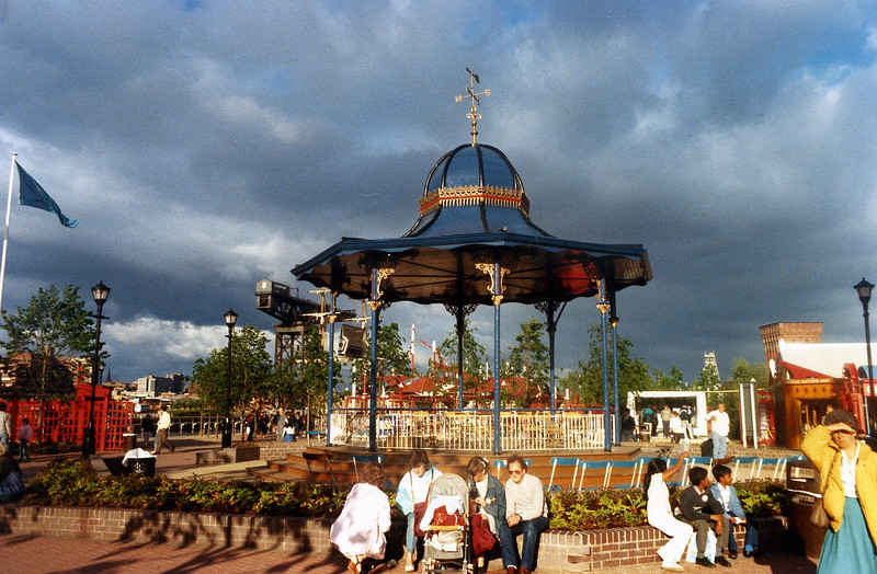"""The Overtoun Bandstand is a fine example of the decorative cast iron street 'furniture' that was produced in Central Scotland's many ironworks and foundries. Arguably, the two foundries most renowned for this work were the Lion Foundry in Kirkintilloch and Walter MacFarlane's Saracen Foundry in the Possil district of Glasgow. The Overtoun Bandstand is a product of the Saracen Foundry. Many of these wonderful structures were sent to cities and towns around the world and a remarkable number of them still exist. A list of surviving bandstands is maintained at the following link on the superb 'Scottish Ironworks' website:<br /> <br />  <a href=""""http://www.scottishironwork.org/datacat.asp?type=ba"""">http://www.scottishironwork.org/datacat.asp?type=ba</a>"""