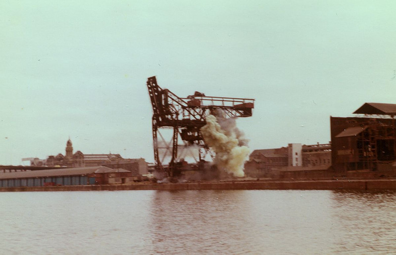 The morning of 5th April 1981 was the designated time for the explosive toppling of the third unloader. However, it proved more resiliant than its sisters and remained standing after the dust of the explosion cleared . Several hours extra work were required to assess the stability of the structure and reset the charges.