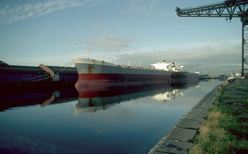 The large Greek-registered vessels Melete (nearest) and Thetis laid up on the Clyde in May 1983. Melete is lying at the part of Mavisbank Quay now occupied by the STV studios while the Thetis occupies the part of Plantation Quay now occupied by BBC Scotland.