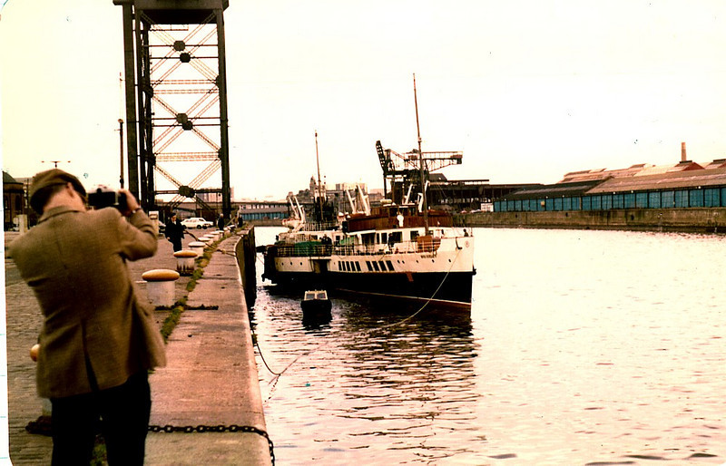 View from Stobcross Quay of the last unloader at General Terminus. PS Waverley, minus funnels, was moving back to her berth at No 52 Stobcross Quay after having her new boiler lifted in by the Stobcross crane earlier in the day, 16th March 1981.