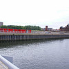 By the time of the Garden Festival in 1988 the three parallel basins of the Princes Dock had been filled in and reclaimed but the canting basin was unchanged. However, during the early years of the 21st century (before 2005) a large section of the southern part of the canting basin was reclaimed. The depth of basin reclaimed was equivalent to the width of the former south basin and half the width of the south pier.<br /> <br /> This view shows the new sheet piled south wall of the canting basin. It will be noted thst vessels can no longer berth directly in front of Govan Town Hall as previously.