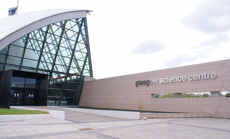The first major redevelopment of the site was only completed in 2001, thirteen years after the Garden Festival had closed. It was a £70m project, partly funded from the Millennium Fund, to provide a new visitor attraction comprising a Science Mall, an IMAX cinema and a large innovative observation tower. <br /> <br /> The Science Centre occupied the western section of Plantation Quay though by that time Plantation Quay had been grouped together with Mavisbank Quay and the Princes Dock under the name Pacific Quay. As that name has no historical relevance to the site it must by intended to focus on the future rather than provide a link to the past. <br /> <br /> Certainly the Glasgow Science Centre building is futuristic in external appearance and, as with other new buildings that were to follow at Pacific Quay, colours were mainly white, shades of grey and silver. Bright pastel colours are rare at Pacific Quay and, indeed across the river at the developments on the former Queens Dock site. The effect in not too bad on a bright sunny day but on a more typical day of dull skies the new buildings tend to reflect and enhance the monotonous greyness that this part of the river has assumed.