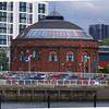 "After standing derelict for some years following the closure of the Glasgow Harbour Tunnel in 1980 the North Rotunda has been operating as a restaurant (and casino for some time) since the late 1980s. It is dwarfed by the modern high rise buildings that have been built around it but it provides a welcome break in style and, particularly, colour from the uniform white, grey and silver hues of the modern buildings<br /> <br /> An accumulator tower similar to those found at the Princes Dock and Queens Dock was built beside the North Rotunda to provide an adequate reservoir of high pressure water to operate the hydraulic hoists that lifted vehicles from the tunnel to ground level and vice versa. The accumulator tower was demolished some time after the vehicular tunnels were closed. <br /> <br /> A picture of the rotunda and accumulator tower can be seen at:<br /> <br /> <a href=""http://www.scran.ac.uk/database/record.php?usi=000-000-487-465-C&PHPSESSID=10nsbjrftacodeqo8157cqqn17&scache=4vb7ekmpjo&searchdb=scran"">http://www.scran.ac.uk/database/record.php?usi=000-000-487-465-C&PHPSESSID=10nsbjrftacodeqo8157cqqn17&scache=4vb7ekmpjo&searchdb=scran</a>"