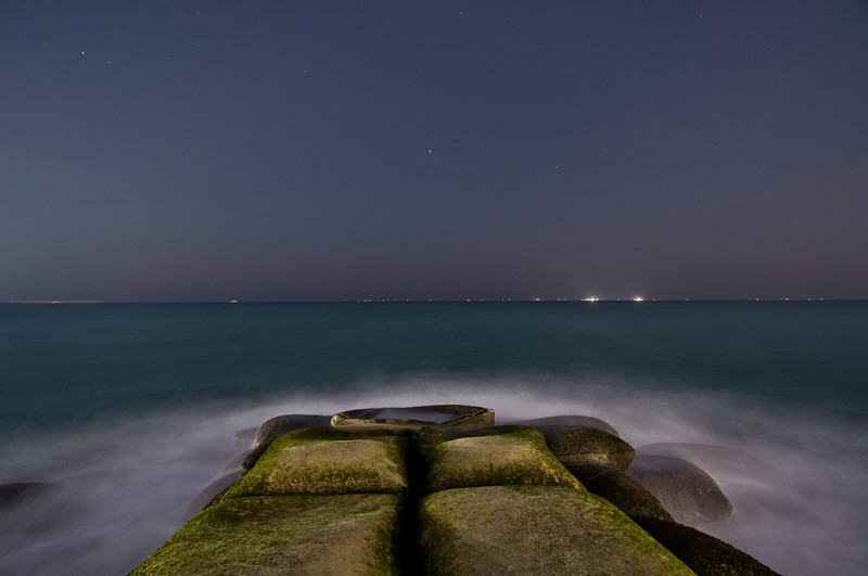 Sandbag breakwater and lights from 'The World'. Dubai, United Arab Emirates