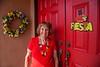 IMG_2791 Jan in Doorway + Fiesta Sign & Spring Wreath - Copy