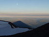 full moon and mountain shadow on the summit of South Sister