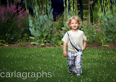 LiamF Walking in Front of Flowers-
