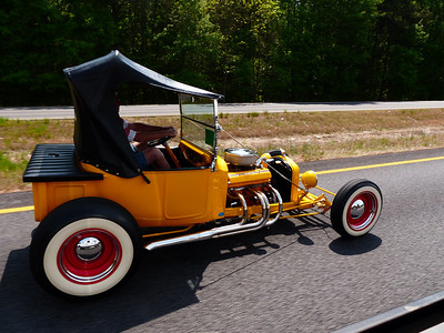 I took this shot while we were driving down the highway.  This guy told us where the car show was.  It was a really good shot as the guy passed us very quickly and I timed it just right to get the shot.  We were moving along at about 65 mph.