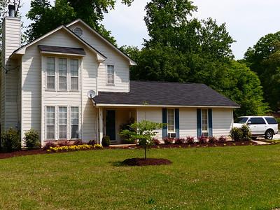 A pretty house with a yard sale