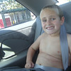 So, this is on the way home from Dry Town...he insists to get dressed in the back seat in the 105 degree heat, but of course I told him he had to have his seat belt on...it was really a sight to behold I tell ya..he's so funny!!