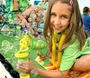 Camryn Herron, 7, makes alot of bubbles with her bubble gun while riding the Church Hill Health Care float during the Fun Fest Parade. Photo by Ned Jilton II