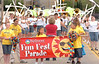 As drill team rifles fill the air behind them, Mary, Rachel and William McCarty lead the 2007 Fun Fest Parade as they carry the banner. Photo by ned Jilton II