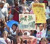 Fans bring signs and cheer on their favorite contestants during Idol finials. Photo by Ned Jilton II