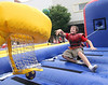 Matthew Collins, 12, of Kingsport, takes a shot at the bungee basketball during Mardi Gras. Photo by Erica Yoon