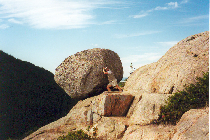"<i>UNH!!!</i> South Bubble, Acadia National Park, Maine  Here I am fooling around on a hike during my very first season on the Trail Crew at Acadia National Park in Maine. Perched atop South Bubble on Jordan Pond we find Bubble Rock, a ""glacial erratic"" that traveled all the way down from Canada on a glacier during the last Ice Age. At that particular time, Acadia was buried under 8,000' of ice. As the glacier finally packed up its icicles and headed home, it left behind this huge boulder sitting here precariously on the edge of South Bubble. This photo was done for the benefit of Lisa and our friends Roger and Maria, who joined Lisa and me in a put-up shot of us trying to move the huge boulder that was blocking the maintenance road down to the Emerald Bay Boat Camp on beautiful Lake Tahoe."