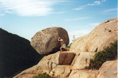 "UNH!!! South Bubble, Acadia National Park, Maine  Here I am fooling around on a hike during my very first season on the Trail Crew at Acadia National Park in Maine. Perched atop South Bubble on Jordan Pond we find Bubble Rock, a ""glacial erratic"" that traveled all the way down from Canada on a glacier during the last Ice Age. At that particular time, Acadia was buried under 8,000' of ice. As the glacier finally packed up its icicles and headed home, it left behind this huge boulder sitting here precariously on the edge of South Bubble. This photo was done for the benefit of Lisa and our friends Roger and Maria, who joined Lisa and me in a put-up shot of us trying to move the huge boulder that was blocking the maintenance road down to the Emerald Bay Boat Camp on beautiful Lake Tahoe."