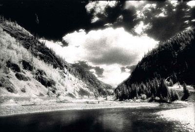 THEY DROPPED THE BOMB!!! Mineral River, San Juan Mountains, Colorado - 1989  That's what the instructor of our photographic workshop said when he looked down this valley and espied this cloud looking every bit as ominous as a true A-Bomb blast. I just had to have it.