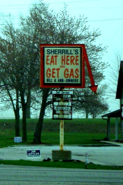 "EAT HERE AND GET GAS<br /> Intersection of Highways 28 and 31, near Tetersburg, Indiana<br /> <br /> Now, this is a sign I've been looking for since I was a teenager and saw one out in the middle of the Texas plains while on a trip from Dallas to El Paso that said, ""Stop, Eat Here, Get Gas."" I've never seen it since, but I laughed my ass off at the time."