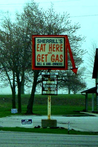 "EAT HERE AND GET GAS Intersection of Highways 28 and 31, near Tetersburg, Indiana  Now, this is a sign I've been looking for since I was a teenager and saw one out in the middle of the Texas plains while on a trip from Dallas to El Paso that said, ""Stop, Eat Here, Get Gas."" I've never seen it since, but I laughed my ass off at the time."