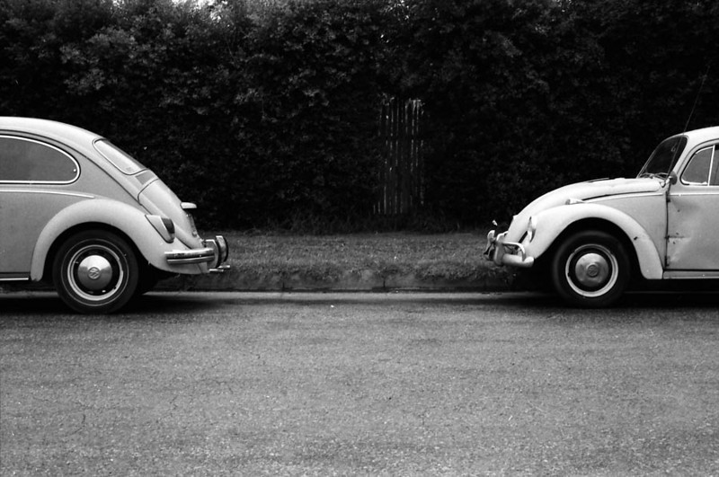 CONTINUED ON NEXT BUG<br /> Southern California<br /> <br /> Just having a little fun with two Volkswagen Bugs parked one in front of the other. If I just could've parked mine in front of or behind one of these, I could've had a real series here. Dang! I'll have to keep that in mind, except I don't have a Bug anymore, which will make that a bit problematic.