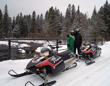 Molly Brennan and Mike Sullivan snowmobiling in Pittsburg NH, March 22nd, 2011. Great trail conditions!