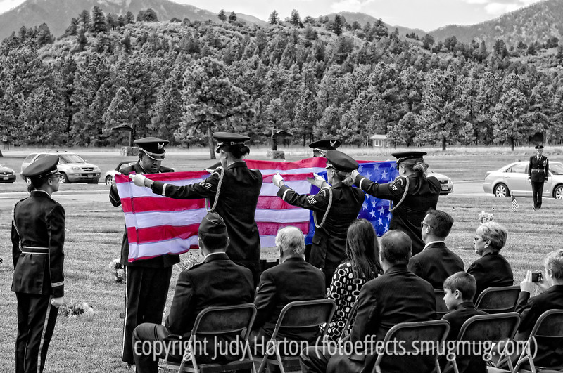 The flag folding ceremony at the funeral of General Robin Tornow at the U.S. Air Force Academy cemetery.