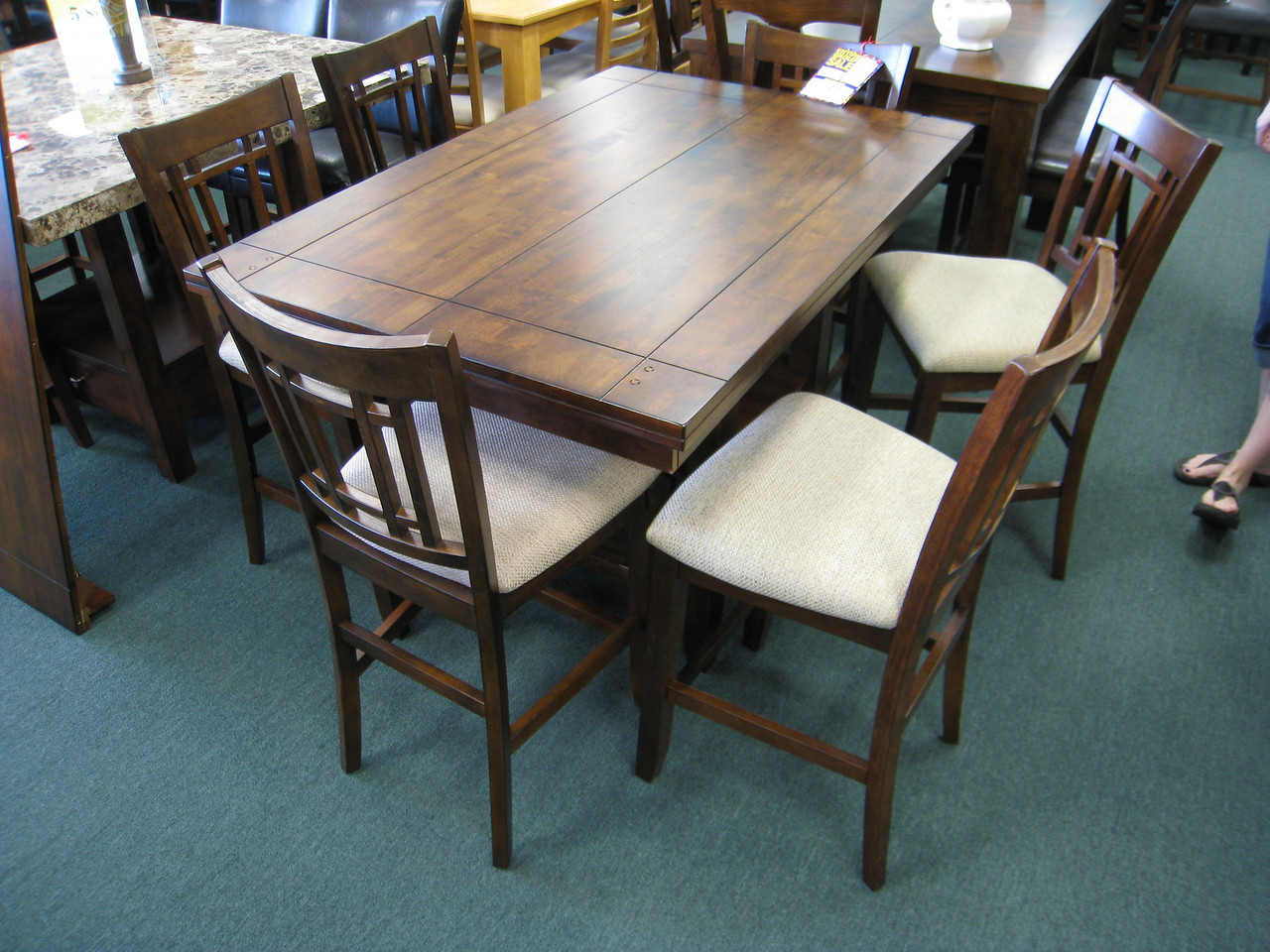 Kitchen table we're considering getting. There is also a leaf that goes in the middle. This is at Dallas Dinettes off I-35.