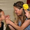 Maria Merritt (left) gets the finishing touches from Wendy Preston (center) as Jordan Preston (right) looks on.<br /> <br /> Photo by Chris Rourke