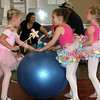Having a ball in the wrestling room before the GAC dance recital.<br /> <br /> Photo by Chris Rourke