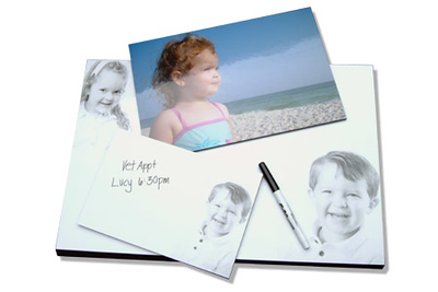 Dry Erase Boards These make great gifts!  Dry erase boards come in three sizes:  6x9 ($25), 8x12 ($30), and 12x18 ($35) and have double-sided sticky tape on the back.  One black erasable marker and clip for placement included.