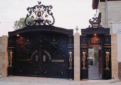2008 GATES: Bronze, Cast iron, Wrought iron. Russia, city of Sochi - Private residence  of a governmental official.  1.5  ton bronze used. main gate 6.8m X 3.5m.+ ornamental center topper  height. walk-through gate 2m X 3.5m.