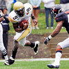 Georgia Tech's  QB Josh Nesbitt (9) runs for yardage as University of Virginia's Corey Mosley (40) defends in the 2nd quarter of play at Scott Stadium in Charlottesville VA Sat. Oct. 24, 2009.