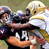 University of Virginia's Matt Snyder (14) and Georgia Tech's Orwin Smith (17) battle during punt coverage in the first quarter of play at Scott Stadium in Charlottesville VA Sat. Oct. 24, 2009. UVA was punting the ball.  Snyder is from Glen Allen.