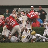 Mr. Moreno, meet Mr. Jefferson : Georgia Tech's  (center) Brad Jefferson (51) catches the University of Georgia's Knowshon Moreno (24) as he tries to jump over the pile in the enzone in the first quarter on Saturday ,11/29/08,  in Sanford Stadium  in Athens, Georgia.  Johnny Crawford/Jcrawford@ajc.com